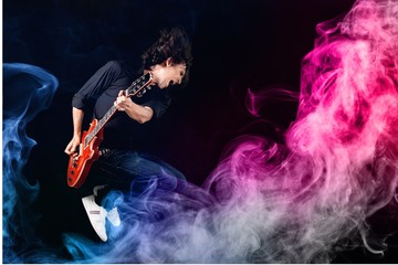 Musician Jumping and color smoke