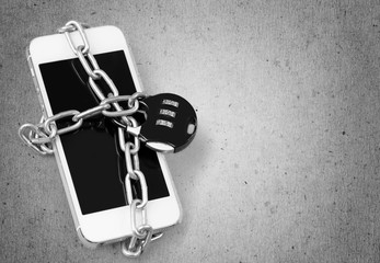 Modern smartphone with combination lock padlock. Concept