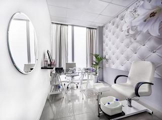 Modern bright beauty salon. Manicure and pedicure interior luxury business