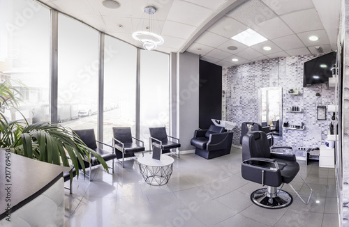 Panorama of a modern bright beauty salon. Hair salon interior ...