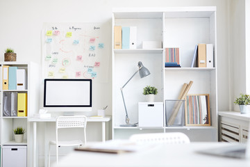 Workplace of modern manager or designer with computer monitor and other supplies
