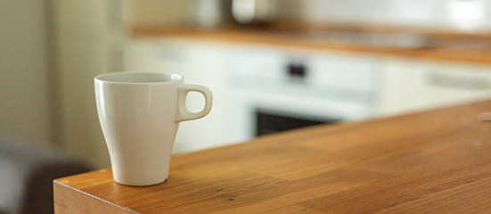 A cup of coffee in the kitchen. Scandinavian style