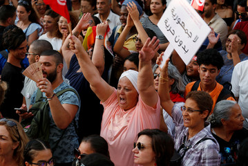 Protesters shout slogans during a rally demanding equal inheritance rights for women, in Tunis