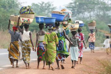 Foto op Canvas Afrika African women carrying bowls on their heads, Benin, Africa