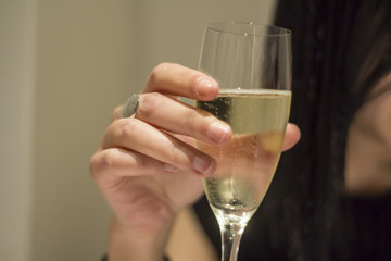 Woman hand holding a glass with Italian sparkling Prosecco wine