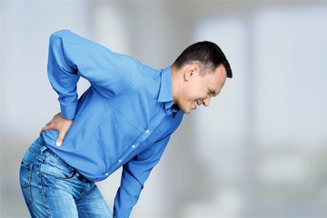Mature man with backache isolated on white