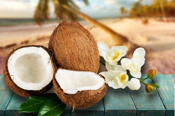 Coconut split open with tropical flowers