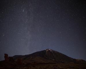 Night sky with shiny stars above volcano El Teide