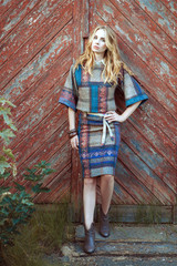 Portrait of a beautiful young woman dressed in the style of boho.