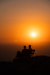 A romantic couple enjoying the beautiful sunset from the Cape Greco in Ayia Napa