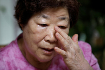 Bae Soon-hui sheds a tear during an interview with Reuters at her home in Seoul