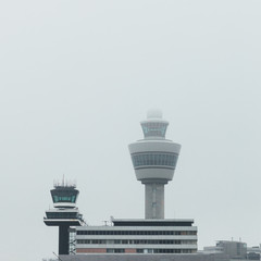 airport traffic control tower at foggy weather