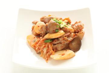 Korean kimchi and pork stri fried with Erigin mushroom