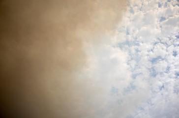 Blue sky with brown smoke