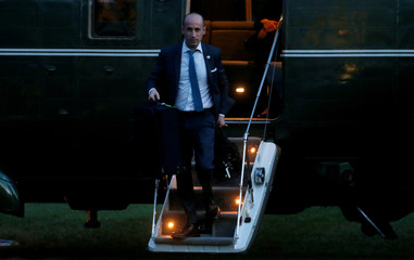 White House policy advisor Stephen Miller exits Marine One behind U.S. President Donald Trump after their arrival from a recent trip to New York on the South Lawn of the White House in Washington