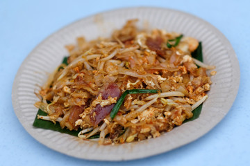 Penang famous hawker food stir fried noodles or called Char Koay Teow served on plate