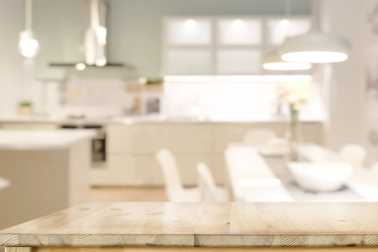 Wooden countertops table with modern kitchen room background.