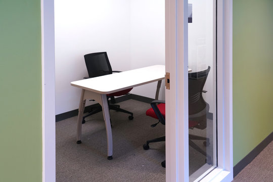 small meeting table and chairs in the small meeting room