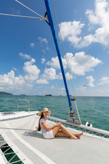 Lifestyle series: Asian woman relaxing on catamaran yacht