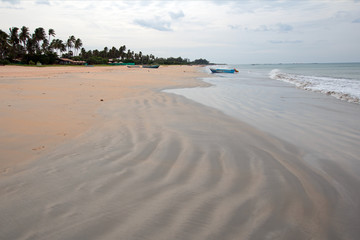 Swirling sand patterns on Nilaveli Beach in Trincomalee Sri Lanka Asia
