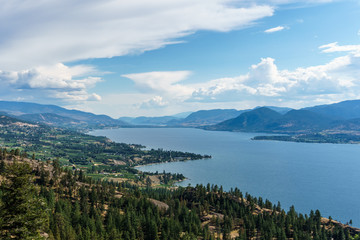 Okanagan lake at summer day with clouds on the sky.