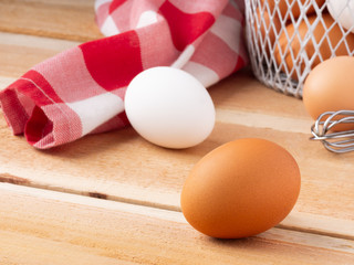 White and Brown Eggs on Rustic Table