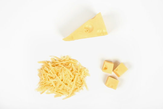 piece of cheese and heap of grated cheese, isolated on white background.