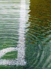 Flooding in artificial grass football field