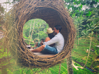 Couple sitting in love nest in the middle of the jungle. Love concept.
