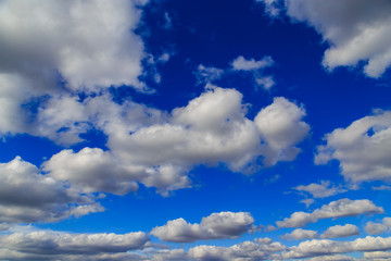 Clouds in the blue sky as an abstract background
