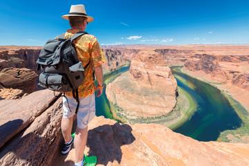 Tourist on Horseshoe Bend view point,  Colorado River, Arizona.