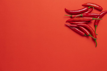 Group of red narrow long spicy chili peppers