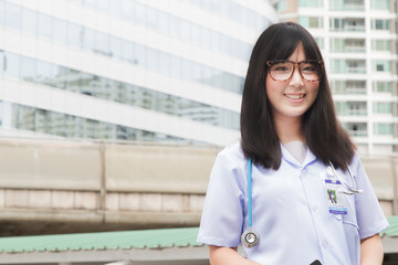 The woman Asian doctor White Shirt suit with stethoscope working outdoor Hospital.