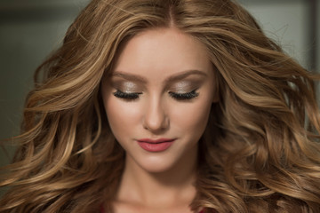 beautiful girl with lush hair and gorgeous makeup