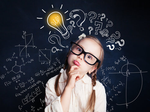 Small child mathematics student thinking on background with lightbulb and math formulas. Kid ideas