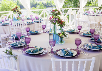 Wedding decoration. Wedding table decor in lavender and emerald