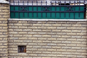 texture of the wall and gray bricks and steel rods