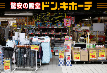 Shoppers browse products at Japanese discount retailer Don Quijote Holdings' store in Tokyo