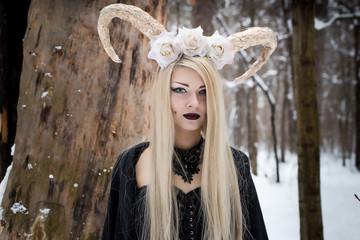 Pretty goth girl walk in snowy forest. Cosplay horny fairy