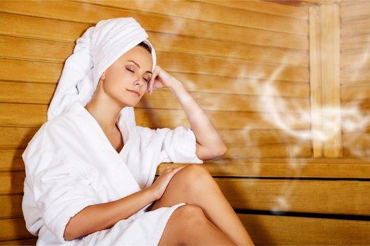Young woman relaxing in spa