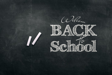 Inscription Back to school, chalk scribble background on blackboard. The concept of the day of knowledge, September 1, the beginning of classes.