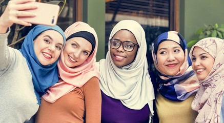 Islamic women friends taking selfie together