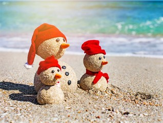 Sandy snowmen. Holiday concept can be used for New Year's and