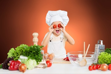 Portrait of adorable little girl preparing healthy