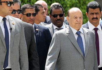 Yemeni President Abd-Rabbu Mansour looks on as he is surrounded by security after his meeting with Arab League Secretary General Ahmed Aboul Gheit in Cairo