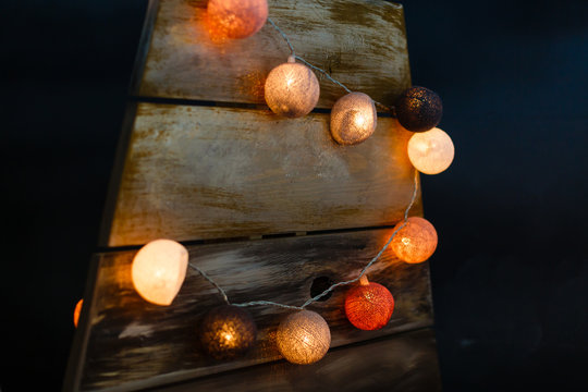 Christmas garland in the form of large colored balls on a black background.