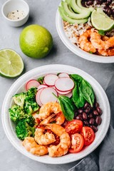 Spicy Shrimp Burrito Buddha Bowl with wild rice, spinach, radish,  tomatoes, black beans and broccoli