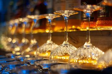 glass row bar counter . Many empty wineglasses