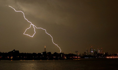 General view as lightning strikes over the city of London, Britain
