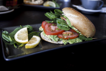 Bagel with avocado, tomato and vegetable